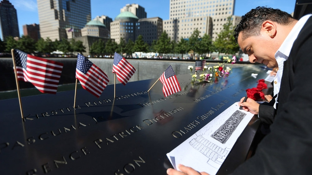 Clever Rivas makes a rubbing of his brother Moises N. Rivas' engraved name during a memorial ceremony at Ground Zero, New York