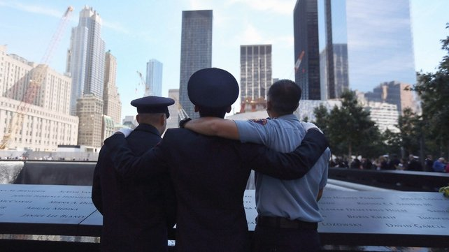Firemen pay their respects at the 9/11 memorial during ceremonies for the eleventh anniversary of the terrorist attacks