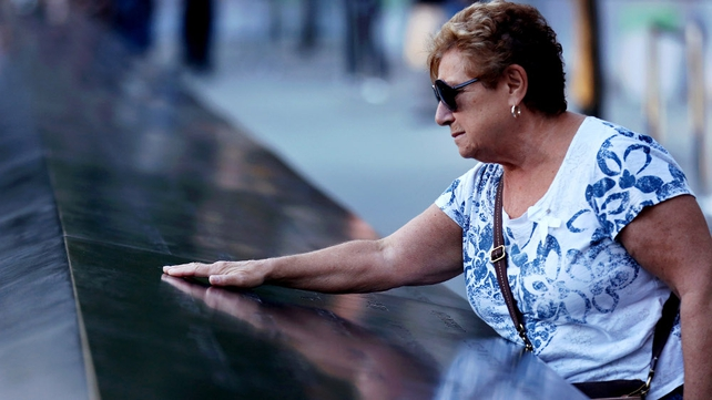 Amelia Tedesco touches the name of her son-in-law Walter Baran on the memorial at Ground Zero