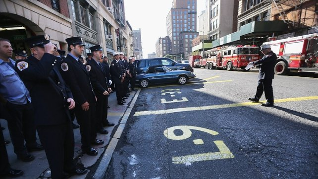 New York City firefighters at Engine 33, Ladder 9 prepare to observe a moment of silence