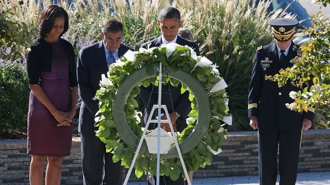 President Barack Obama lays a wreath while flanked by his wife  Michelle Obama, Secretary of Defense Leon Panetta and Chairman of the Joint Chiefs of Staff Gen  Martin Dempsey (R)