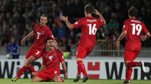 Daniel Da Mota's team-mates celebrate with the goalscorer after he earned the visitors an undeserved draw at Windsor Park