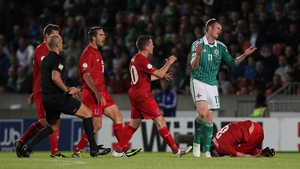 Chris Brunt reacts after fouling Gilles Bettmer of Luxembourg