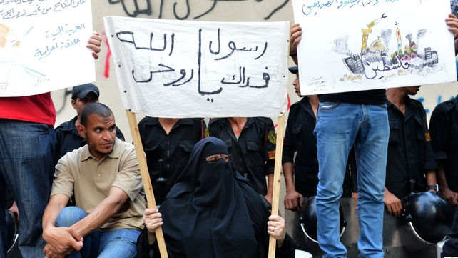 Egyptian protesters hold placards during a demonstration against a film deemed offensive to Islam