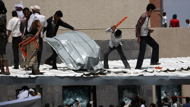 Yemeni protesters try to break through the US embassy in Sanaa