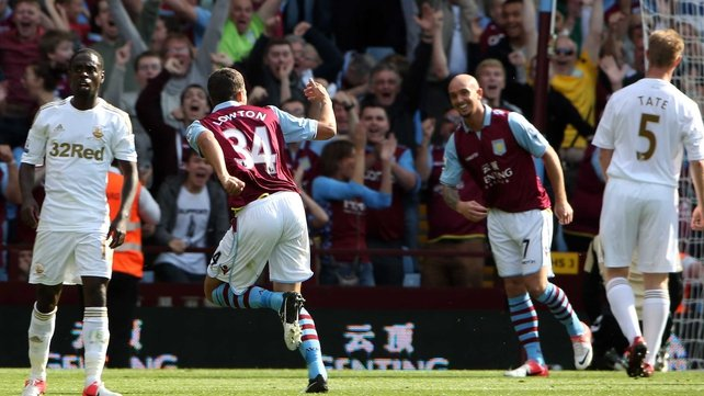 Matthew Lowton (number 34) celebrates breaking the deadlock for Aston Villa