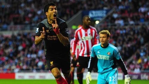 Luis Suarez looks unlikely to leave Anfield