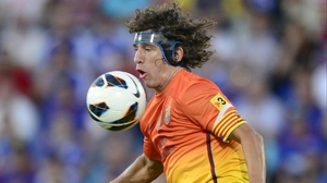 Carles Puyol will miss the start of Barcelona's Champions League campaign