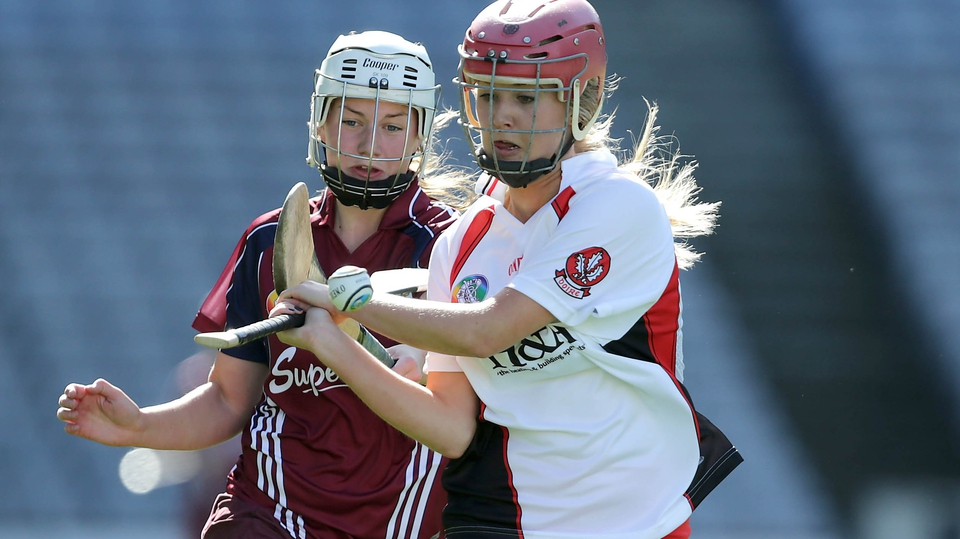 Galway's Paula Kenny attempts to hook Aileen McCusker of Derry