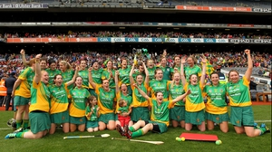 The Meath team celebrate with the trophy