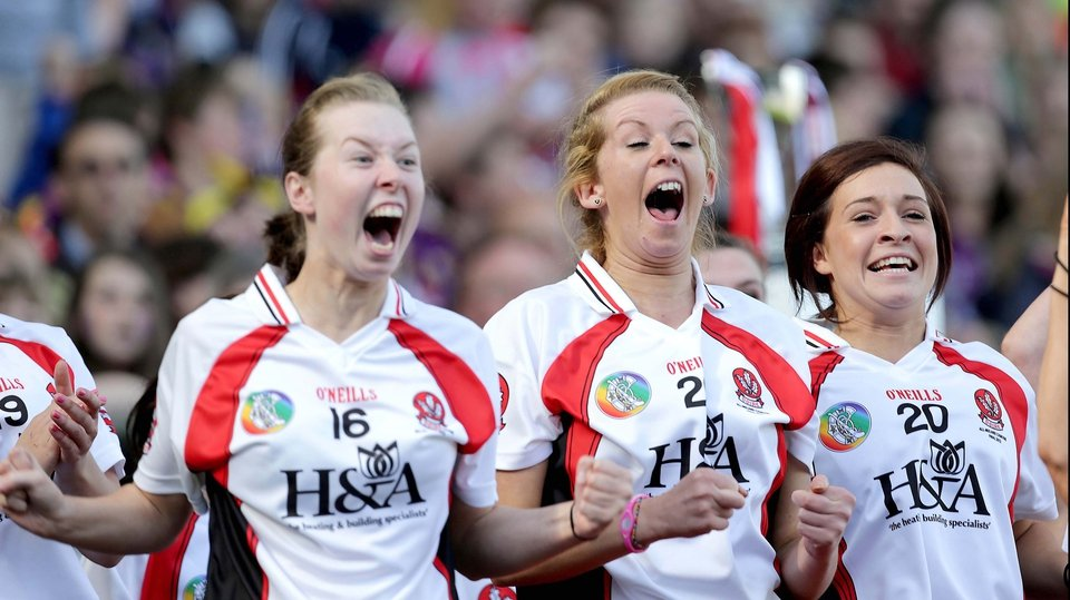 Derry substitutes celebrate their team scoring that penalty