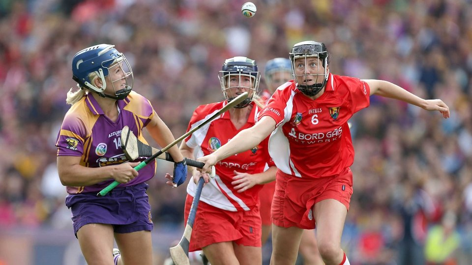 Katrina Parrock of Wexford looks to keep possession from a pair of Cork players