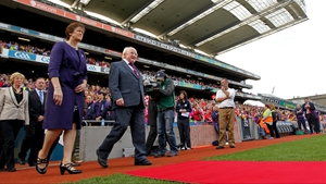 President of the Camogie Association Aileen Lawlor (l) and President of Ireland Michael D Higgins walk out to meet the teams before the Senior final