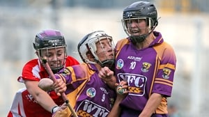 Kate Kelly of Wexford is sandwiched between team-mate Michelle O'Leary and Cork's Anna Geary