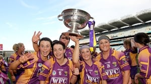 The Wexford players celebrate with the O'Duffy Cup