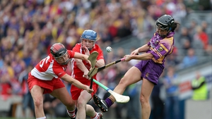 Claire O'Connor of Wexford is closed down by Síle Burns (l) and Briege Corkery of Cork
