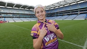Wexford goalkeeper Mags D'Arcy celebrates winning a third successive All-Ireland title