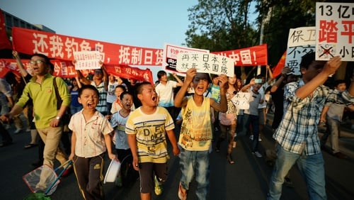 Chinese protesters stage an anti-Japan rally outside the Japan Embassy yesterday