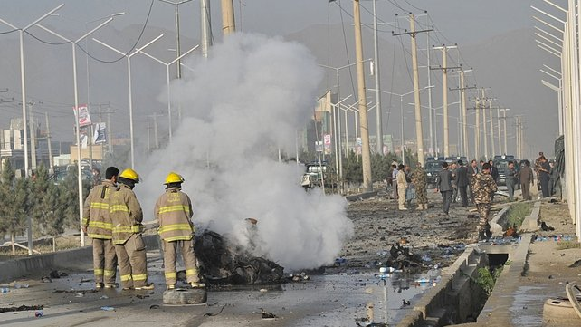 A suicide bomber blew herself up alongside a minivan on a major highway leading to the international airport