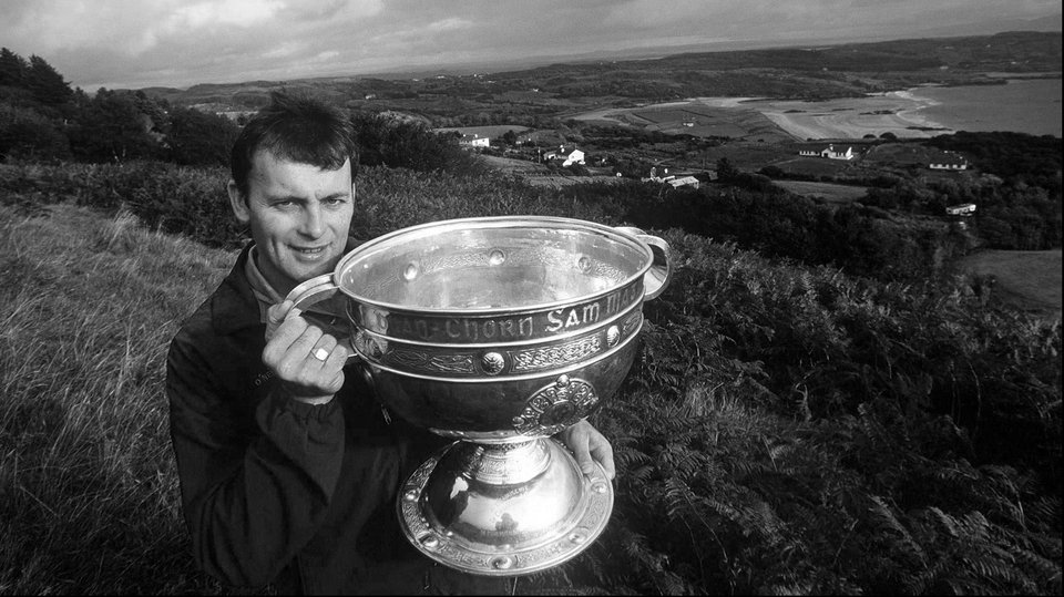 Donegal captain Anthony Molloy shows the Sam Maguire around where it would reside for the winter