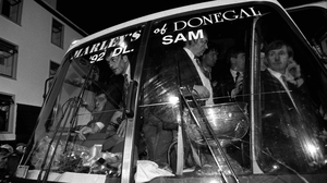 The coach carrying the Donegal team and the Sam Maguire arrives in Donegal town