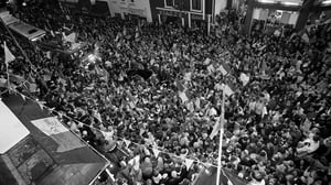 Fans gather in the streets to catch a glimpse of their heroes