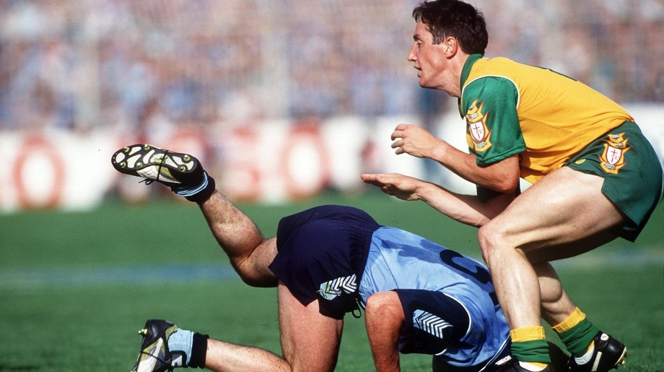 Paul Curran of Dublin collides with Jim McMullin of Donegal