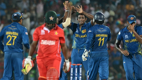 Sri Lanka's Ajantha Mendis (centre) ensured Zimbabwe's Prosper Utseya did anything but in Hambantota, dismissing him for just a single run