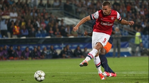 Lukas Podolski is set to miss at least eight weeks of action