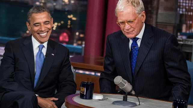 President Obama and David Letterman speak during a break in the taping of the 'Late Show with David Letterman'