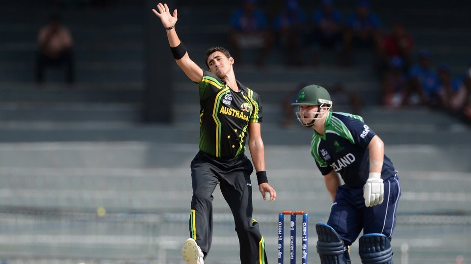 Mitchell Starc in full flight bowling at the Irish top order