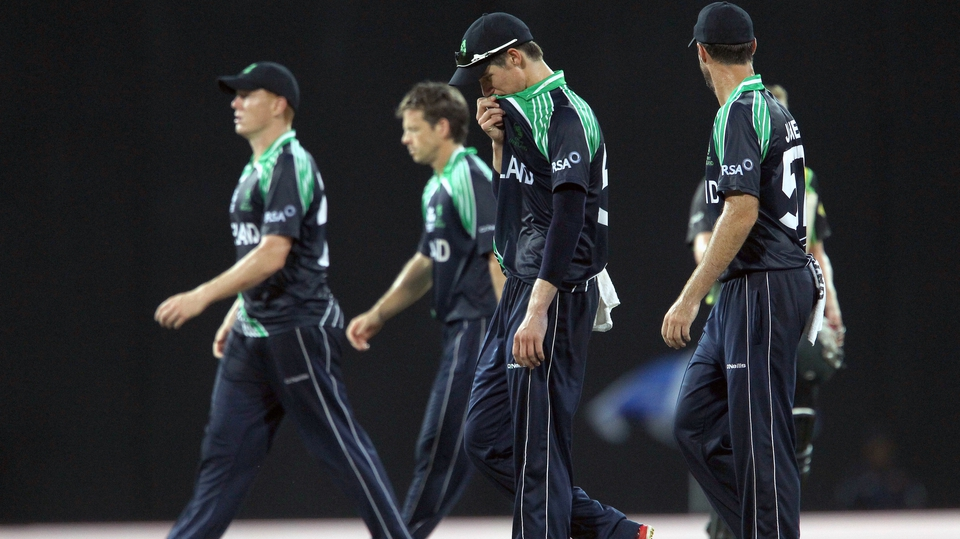 The Ireland players leave the field following their comprehensive defeat to Australia