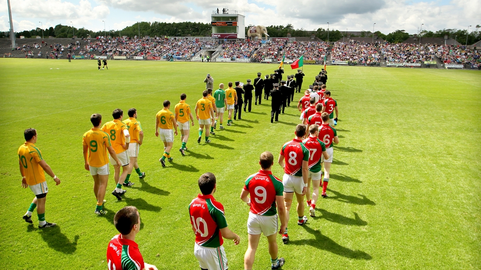 The Leitrim and Mayo teams parade before their Connacht semi-final in Castlebar