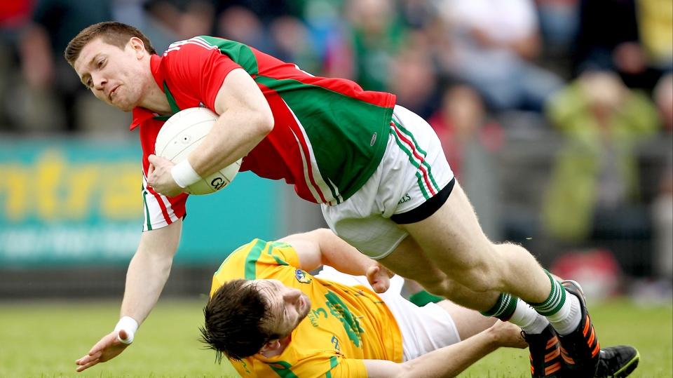 Mayo's Enda Varley is challenged by Fabian McMorrow