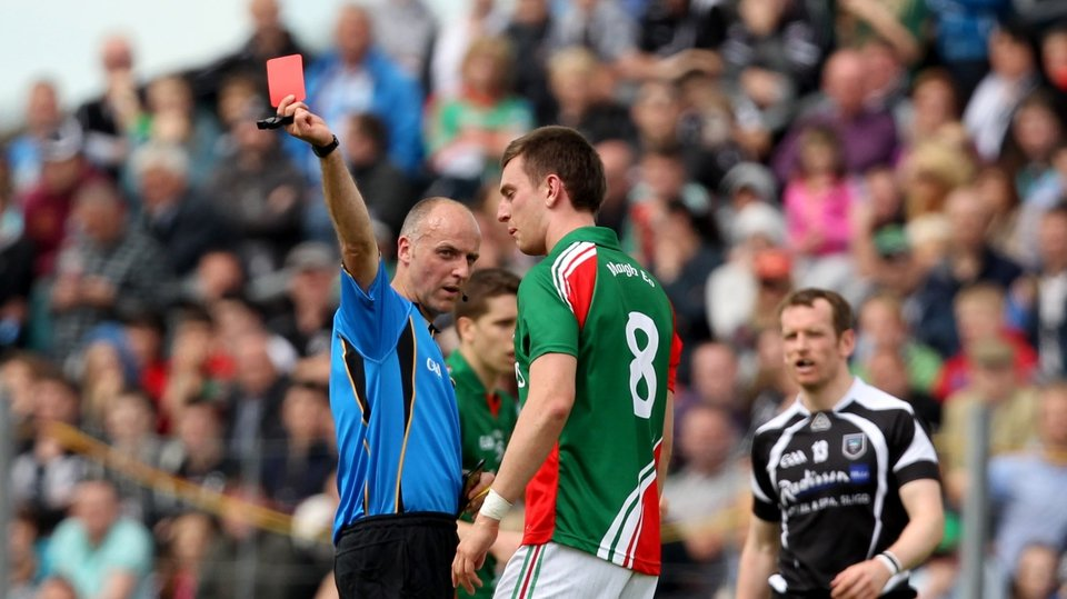 Mayo midfielder Barry Moran is shown a red card by referee Cormac Reilly