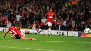 Michael Carrick goes to ground while netting the opener after only 7 minutes
