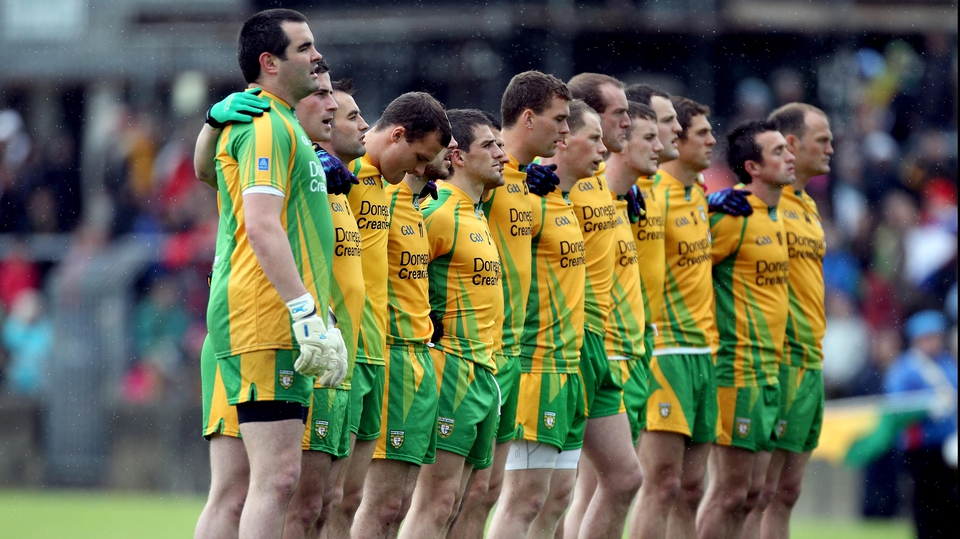 The Donegal team stand for the national anthem before their Ulster quarter-final with Derry in Ballybofey