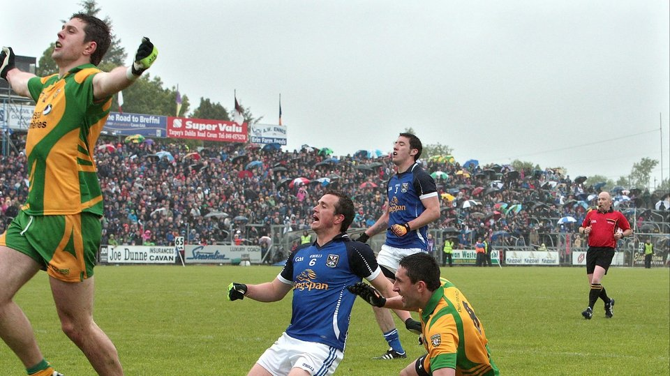 Donegal's Ryan Bradley (far left) celebrates after team-mate Rory Kavanagh scores their goal (on ground) in a 1-16 to 1-10 victory