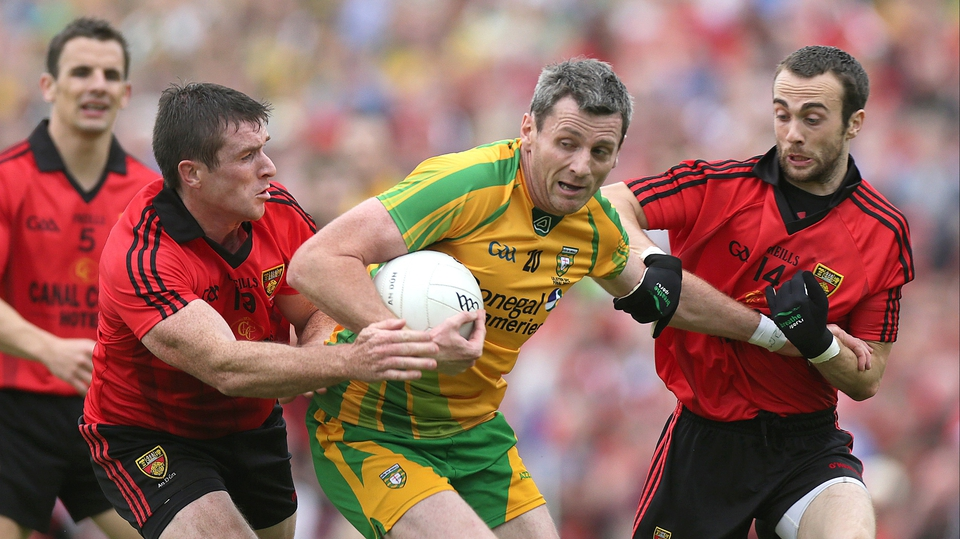 Donegal's Christy Toye is surrounded by Down duo Conor Laverty and Liam Doyle in the Ulster decider at Clones