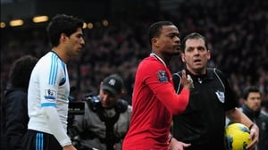 Luis Suarez (l) and Patrice Evra (c) are not exactly on the best of terms