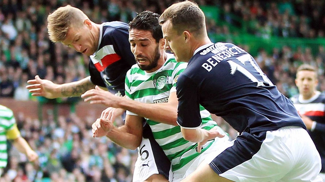 Lassad Nouioui of Celtic tries to go between Steven Milne and Kyle Benedictus of Dundee