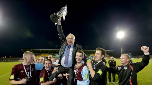 Drogheda United manager Mick Cooke celebrates winning the EA Sports Cup with his players