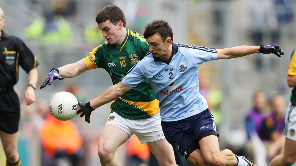 Cillian O'Sullivan of Meath and Dublin's Emile Mullan tussle for possession