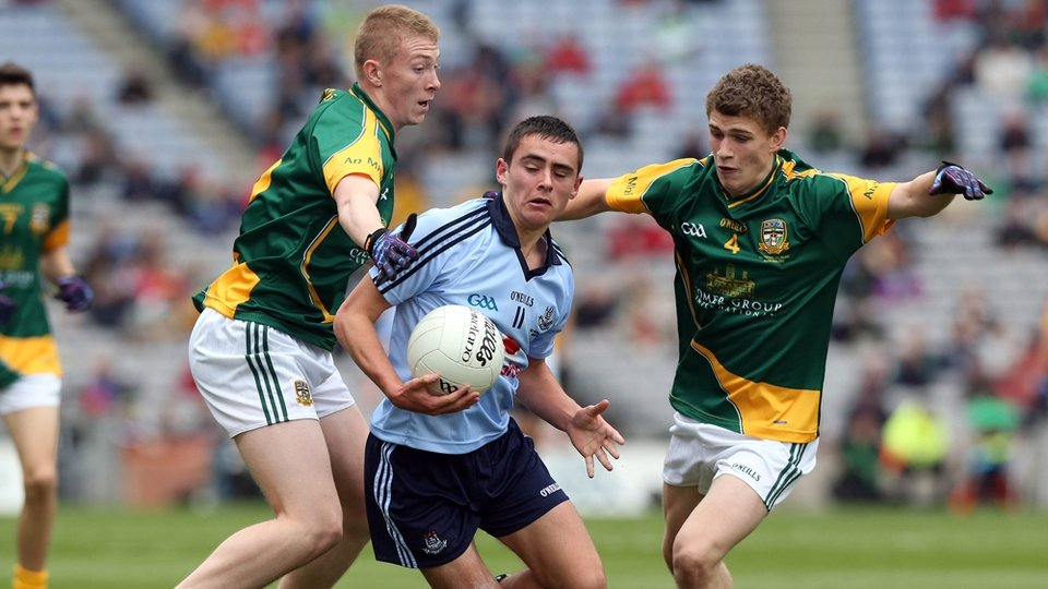 Dublin's Niall Scully is confronted by two Meath players