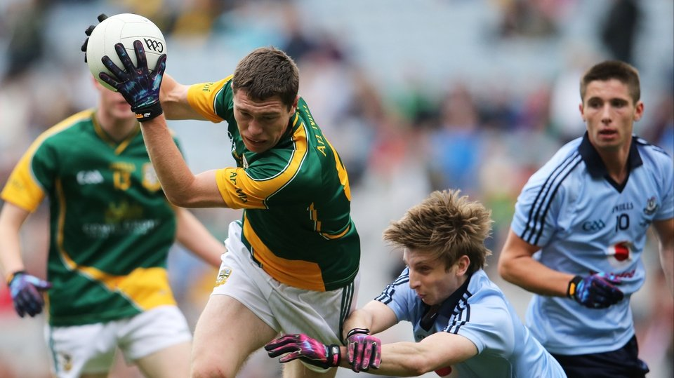 Meath's Padraic Harnan is tackled by Ross McGowan of Dublin in the minor decider