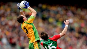 Neil MeGee rises above Michael Conroy of Mayo