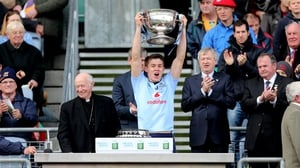 Dublin captain David Byrne lifts the trophy after the Metropolitans' 0-14 to 1-05 victory