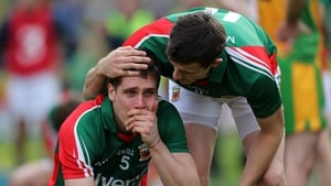 Mayo's Lee Keegan is consoled by team-mate Jason Doherty at the end of the game