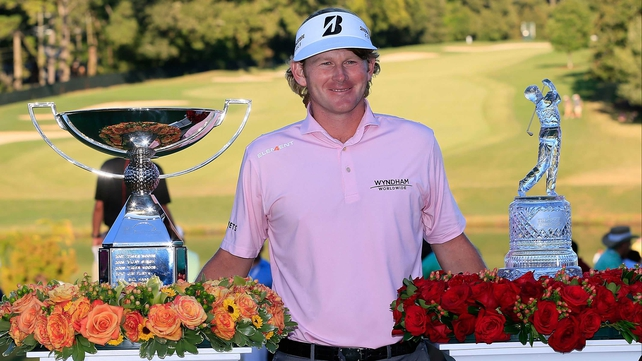 Snedeker with the FedEx Cup (left - the one that netted the $10m bonus!!!) and the Tour Championship trophy