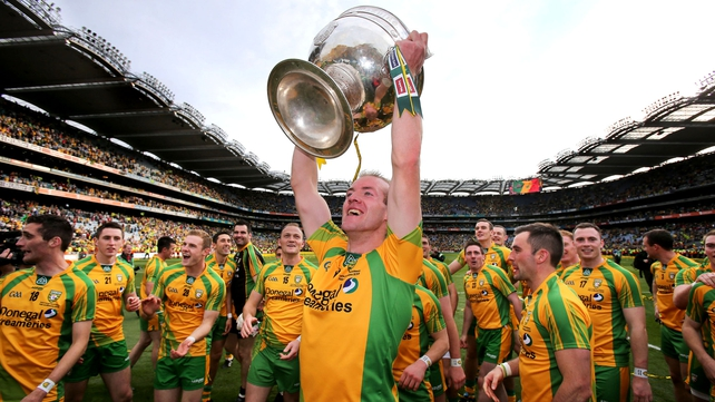 Donegal's Neil Gallagher lifts the Sam Maguire in front of Hill 16